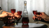 Four friends hold glasses with cranberry tincture video
