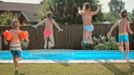 SLO MO DS Four kids jumping into the pool video