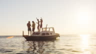 SLO MO DS Four people partying on a boat video