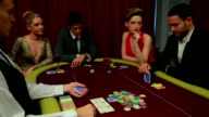 Four people playing poker and one going all in video