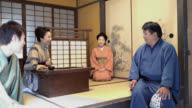 Four people talking in Japanese style clothing and room video