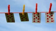 four playing cards on clothes-line video