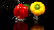 Four videos of falling bell pepper in real slow motion video