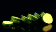 Four videos of falling cucumber in real slow motion video
