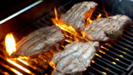 Four videos of grilling steaks on the fire-real slow motion video