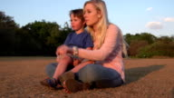 Four year old boy sitting on mothers lap and interacting,South Africa video