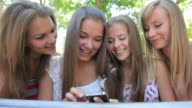 Four young woman in summer outdoors sidewalk cafe video
