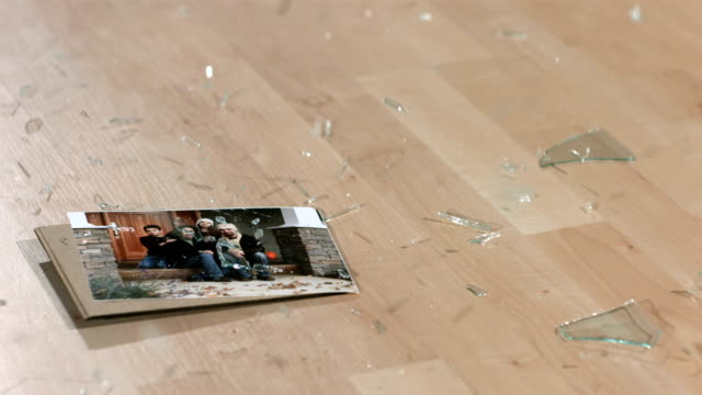 Framed family photo falling and breaking, backwards video