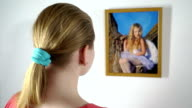 Framed photo prints hanging on the wall girl holding a photograph of little girl video