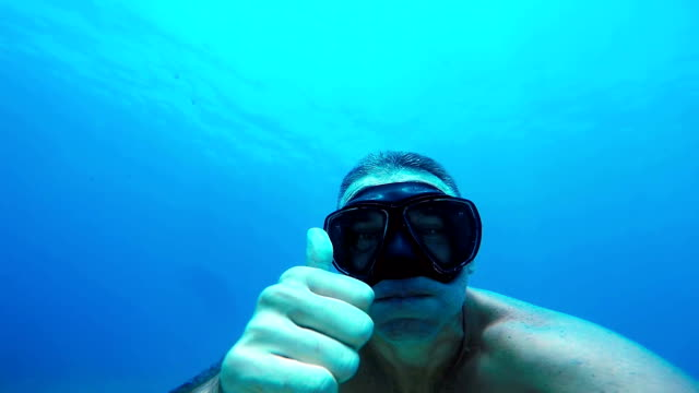 Free Diver Underwater Showing OK Sign in Slow motion. video