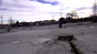SLOW MOTION: Free runner does front flip into the puddle video