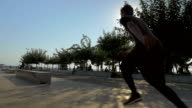 Free runner on city square on sunny day video