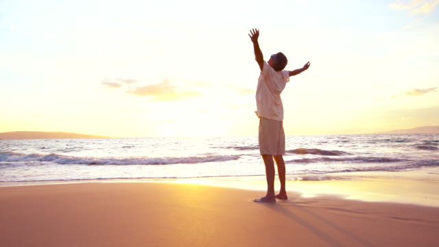 Freedom at the Beach. Mature Retired Man Having fun at Sunset video