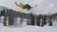 AERIAL SLOW MOTION: Freestyle skier jumping over big air kicker video
