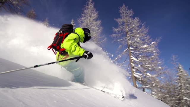 Freestyle skier riding powder snow video