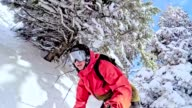 TW Freestyle snowboarder skiing through wilderness area video