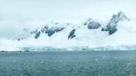 Freezing Cold Antarctica with Tall Ice Covered Mountains video