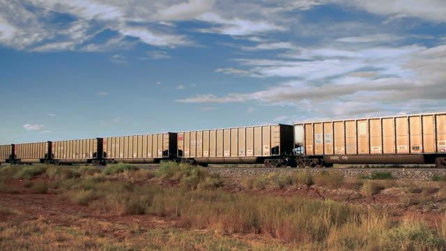 freight train crossing desert video