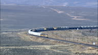 Freight Train On Way To Medicine Bow  - Aerial View - Wyoming, Big Horn County, United States video
