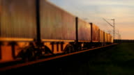 Freight Train Passing By At Sunset video
