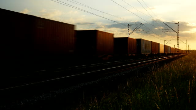 PAN Freight Train Passing By At Sunset (4K/UHD to HD) video