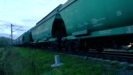 Freight train with cargo containers passing by video