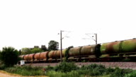 Freight train with petroleum tank cars passing video
