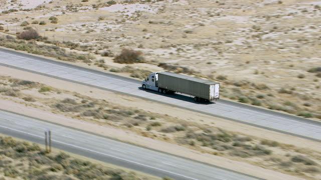 Freight truck driving on highway through desert video