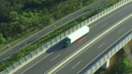 AERIAL: Freight truck transporting cargo over highway viaduct video