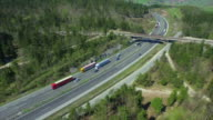 AERIAL: Freight trucks transporting the cargo on a freeway video
