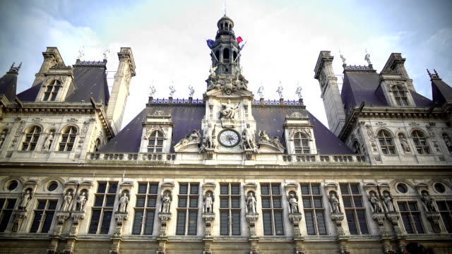 French and EU flags waving atop Hotel de Ville city administration in Paris video
