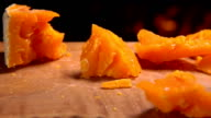 French cheeses on a board near the burning fireplace video