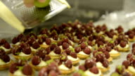 French cook adding zest from lime to raspberry cakes video