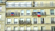 French flags hanging on balconies beautiful building, architecture, patriotism video