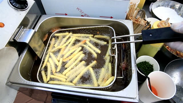 French fries cooking in hot oil video