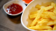 French fries, fried yellow pepper sauce and ketchup. video