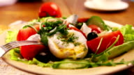 French national meal : Poached egg with salad and lemon juice video