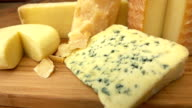 French of cheese on a wooden table. video