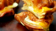 Fresh baked ham and cheese croissant video