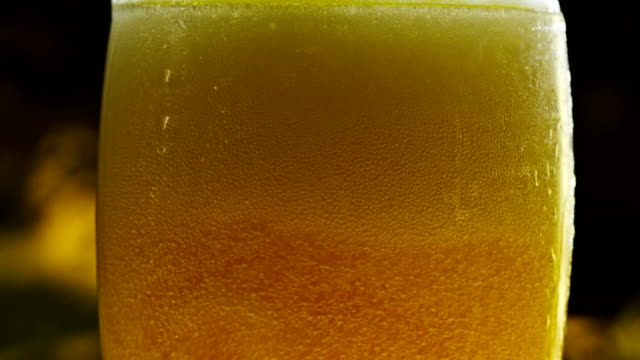 Fresh Beer pours into cold Glass video