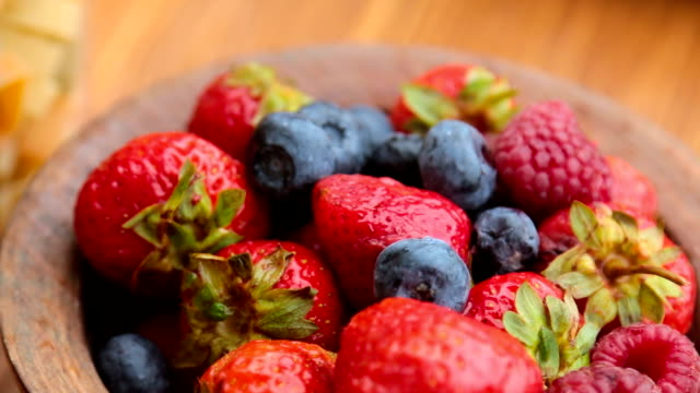 fresh berries , strawberries, raspberries, blueberries in a copper bowl video