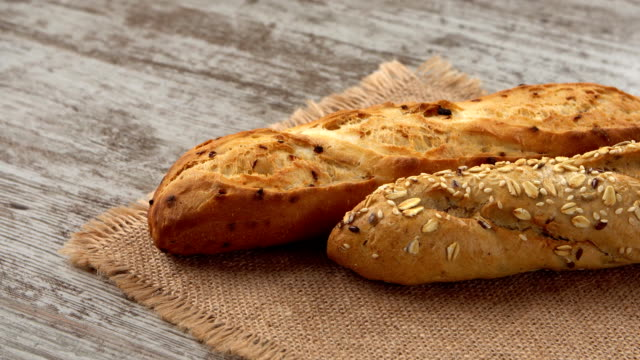 Fresh bread on the kitchen table. Healthy eating and traditional bakery concept video