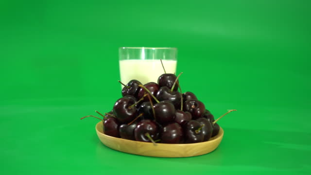 fresh cherry with milk on wood plate video