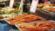 Fresh cooked seafood selling at Shilin Night Market, Taiwan. Street food chinese style in Taipei video
