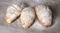 Fresh croissants sprinkled with powdered sugar. video
