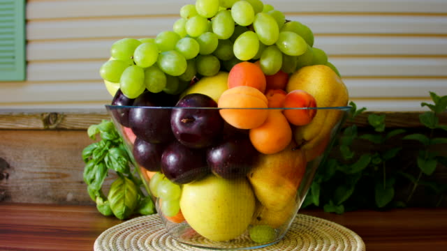 Fresh fruit in a large glass vase video