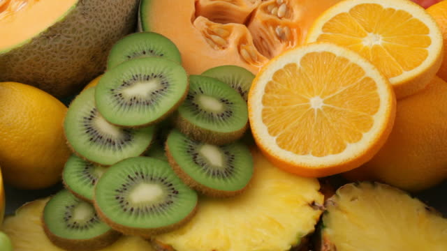 Fresh fruits background, fly over video