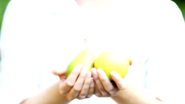 Fresh fruits in woman's hands. video