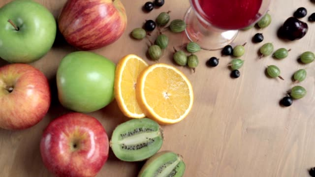 Fresh fruits on the table. Fruits still life. Fruits mix video