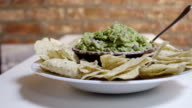 Fresh homemade Guacamole and tortilla chips. video